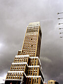 Kane Office Tower on 7th Avenue in New York City. The building is tilted against a cloudy sky. Picture has a painter like quality about it. USA.