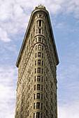 The Flatiron (architect Daniel Burnham, 1902) building on 23rd Street and 5th Avenue in New York City looking straight up from 23rd, NYC. USA (Spring, 2005)