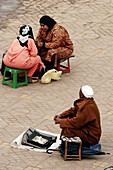 Fortune tellers working on the Jemaa El Fna Square, Marrakech, Morocco