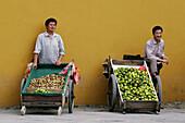 Two local fruit sellers in Suzhou, Jiangsu Province, China