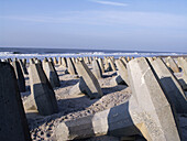 On the west coast of Jutland in Denmark, the coast is protected against erosion from the north sea with big concrete blocks