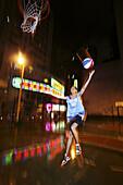 Playing basketball in the streets of Hong Kong. China.