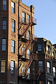 Fire escape, late afternoon sun, on a Bostons Back Bay townhouse. USA.
