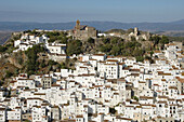 The church on top of the hill is Iglesia de la Encarnacion.Casares is a tipical white village near Costa del Sol. It seem like a treasre shinning under the strong Andalucian sun.