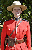 Comox Nautical Days Parade. A young female Royal Canadian Mounted Police officer in uniform. BC, Canada