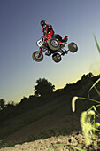 action, motocross, solo caucasian male jumping All-Terrain-Vehicle. Kansas City, Missouri, USA