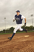 Action, Activity, Adult, Adults, Baseball, Caucasian, Caucasians, Color, Colour, Compete, Competing, Competition, Competitions, Contemporary, Costume, Costumes, Daytime, Determination, Effort, Efforts, Exterior, Fast, Field, Fields, Full-body, Full-length
