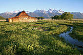 The Moulton Barn stands tall before the Tetons after over 100 hard winters, Grand Teton National Park, Wyoming, USA.