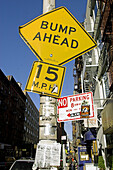 Street signs, no parking, bump ahaead, NYC. USA