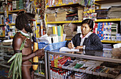 Dani hunter in an indonesian shop in Wamena, Baliem valley, Western Papuasia, Former Irian-Jaya, Indonesia