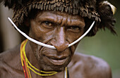 Dani man with head-dress and nose adornment made of bones, Western Papuasia, Baliem valley, Former Irian-Jaya, Indonesia