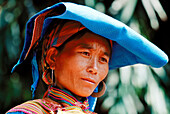An ethnic flowery Hmong woman wears intensely embroideres and highly colorful clothing. Lung Khau Phin. Lao Cai province. Vietnam.