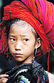 Ethnic Red HMong girls can often be distinguished by their Big Hair. Muong Hum. Lao Cai province. Vietnam.
