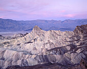 Pre-sunrise glow on Manley Beacon as seen from  Zabriskie Point. Death Valley National Park. California. USA.