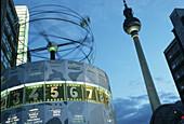 Weltzeituhr (World Time Clock) and Fernsehturm (TV tower) in Alexanderplatz, Berlin. Germany