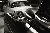 Rearview mirror of a classic car from the 40s or 50s.