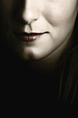 Young womans face. Smile detail.