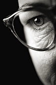 Face with wrinkles. Detail of eye with glasses.