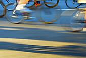 bike racers on street racing