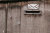 Close up, Close-up, Closeup, Color, Colour, Daytime, Detail, Details, Door, Doors, Exterior, Letter, Letters, Mailbox, Mailboxes, Outdoor, Outdoors, Outside, Symbol, Symbols, Wood, Wooden, T65-623775, agefotostock