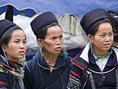 Three black Hmong women in the weekend market. Sapa, Vietnam (april 2006)