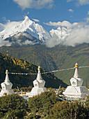Holy Kawa Karpo peak and stupas fronting it, Shangri La, Dequin Tibetan region, China