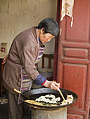 cooking potstickers, Lijiang, China