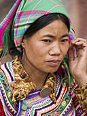 portrait of beautiful Hani woman, Shalatou market, Yunnan, China