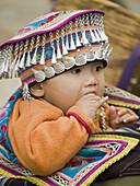 regally dressed Hani boy, Yuanyang, China