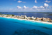 Hotel zone of Cancún and caribbean sea. Cancun developped in 1970 in an island in the Caribbean sea and the Nichupte lagoon. There are 26000 rooms and it produces 21% of the tourism profits of Mexico.