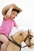 Candid, Caucasian, Caucasians, Child, Childhood, Children, Color, Colour, Contemporary, Cowboy, Cowboys, Facial expression, Facial expressions, Female, Game, Games, Gesture, Gestures, Gesturing, Girl, Girls, Grin, Grinning, Happiness, Happy, Hat, Hats, He