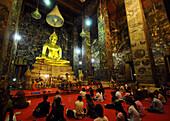 People praying in Wat Suthat, Royal Temple, Bangkok, Thailand