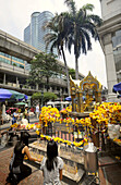 Two female worshippers in front of the Erawan Shrine, Bangkok, Thailand