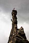 Rock climbers on the towers of the small (left) and large (right) Hercules Column, Bielatal, Elbe Sandstone Mountains, Saxon Switzerland, Saxony, Germany