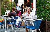 People in a cafe, Kaertner Straße, Vienna, Austria