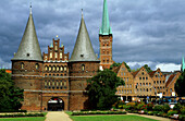 The Holstentor under clouded sky, Luebeck, Schleswig Holstein, Germany, Europe