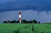 Lighthouse Flügge under dark clouds, Fehmarn island, Schleswig Holstein, Germany, Europe