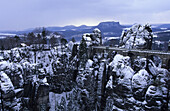 View to Bastei bridge in winter, Saxon Switzerland, Elbe Sandstone Mountains, Saxony, Germany