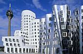 Gehry Buildings, Neuer Zollhof, Rheinturm im background, Media Harbor, Dusseldorf, North Rhine-Westphalia, Germany