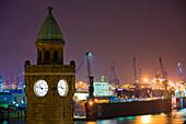 St. Pauli Landungsbrucken and harbor at night, Hamburg, Germany
