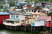 Wooden huts in the main town of Castro, Chiloé island, Chile, South America