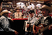 Three musicans and a bar keeper in a saloon in San Miguel de Allende, Mexico