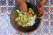 Person preparing guacamole, San Miguel de Allende, Mexico