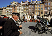 Poland Warsaw, The Old Town ( Stare Miasto ) Square, Partially surrounded by medieval walls is the oldest district in Warsaw, from 13 century, Then main section of Warsaw, Now main tourist attraction with carriages cafes restaurants and shops