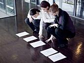 Three businesswomen reading documents, Munich, Bavaria, Germany