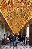 Tourists visiting the Gallery of Maps, Vatican Museums, Vatican City, Rome, Italy