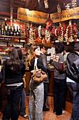 People in a delicatessen store at Campo de Fiori, Rome, Italy