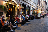 Guests in a pavement cafe, Trastevere, Rome, Italy