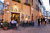 Guests sitting outside a bar in the evening, evening, Trastevere, Rome, Italy