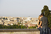 Young couple kissing  on Janiculum Hill, Rome, Italy
